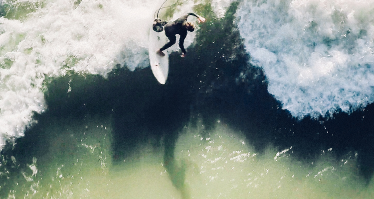 1_Surfers ride dangerous flowing rivers